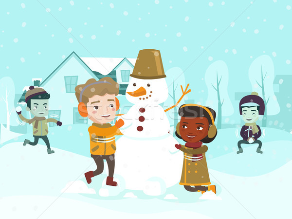 Multicultural children making a snowman. Stock photo © RAStudio