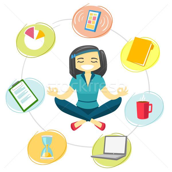Business woman meditating in yoga lotus position. Stock photo © RAStudio
