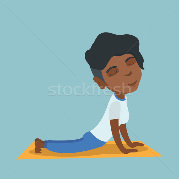 African woman practicing yoga upward dog pose. Stock photo © RAStudio
