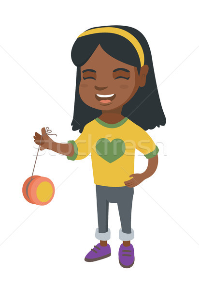 African-american girl playing with yo-yo. Stock photo © RAStudio