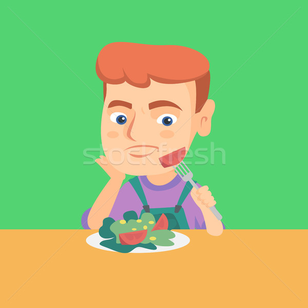 Boy refusing to eat salad with healthy vegetables. Stock photo © RAStudio