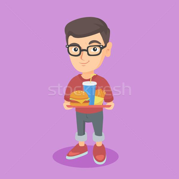Pequeno caucasiano menino bandeja fast-food Foto stock © RAStudio