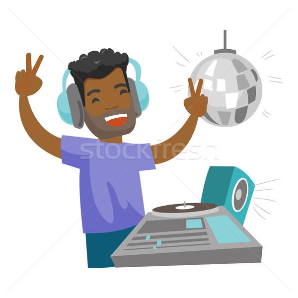 DJ mixing music on turntables in the night club. Stock photo © RAStudio