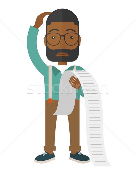 Sad african-american employee holding a list of payables. Stock photo © RAStudio