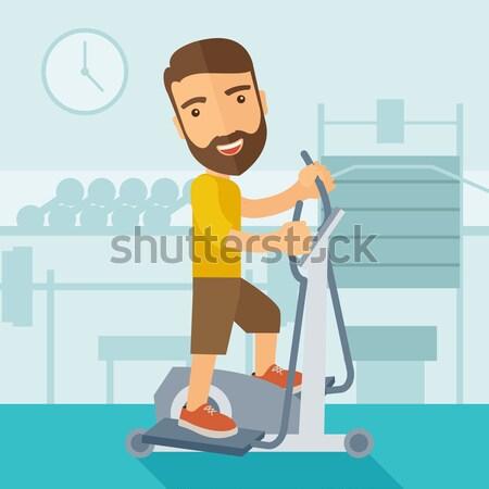 Man in gym sport workout exercises. Stock photo © RAStudio