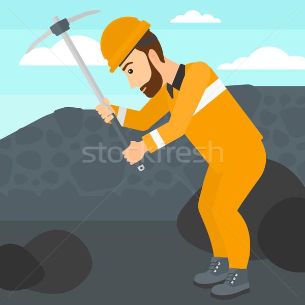 Miner working with pick. Stock photo © RAStudio
