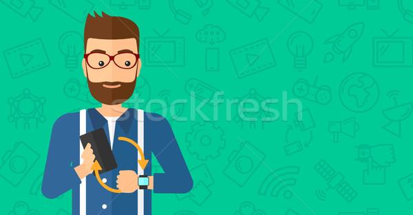 Synchronization of smartphone and smartwatch. Stock photo © RAStudio