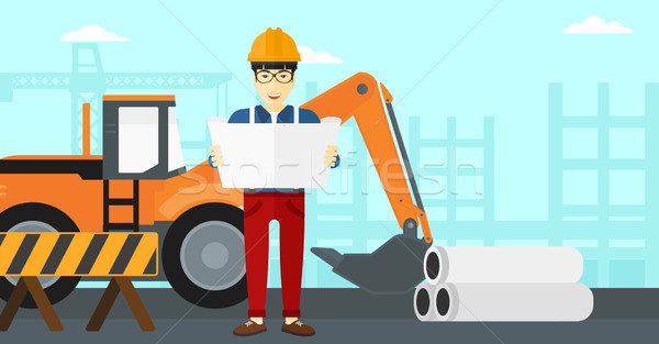 Engineer holding a blueprint. Stock photo © RAStudio