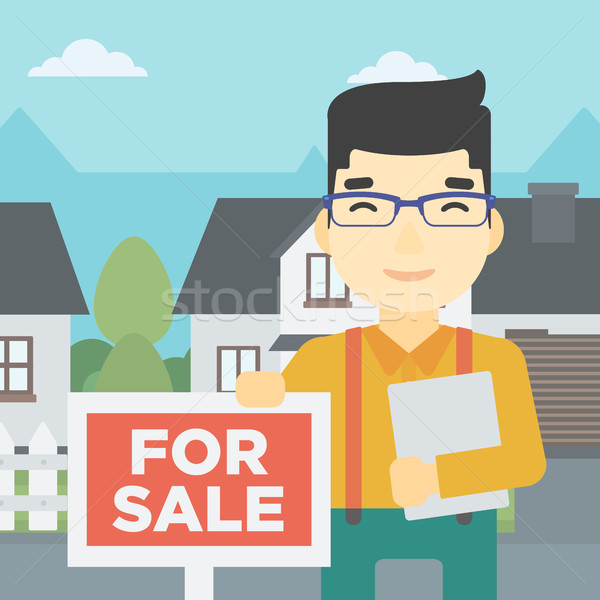 Agent immobilier offrant maison asian jeunes Homme Photo stock © RAStudio
