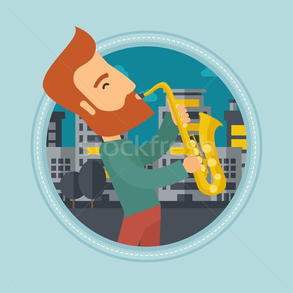 Müzisyen oynama saksofon kafkas adam Stok fotoğraf © RAStudio