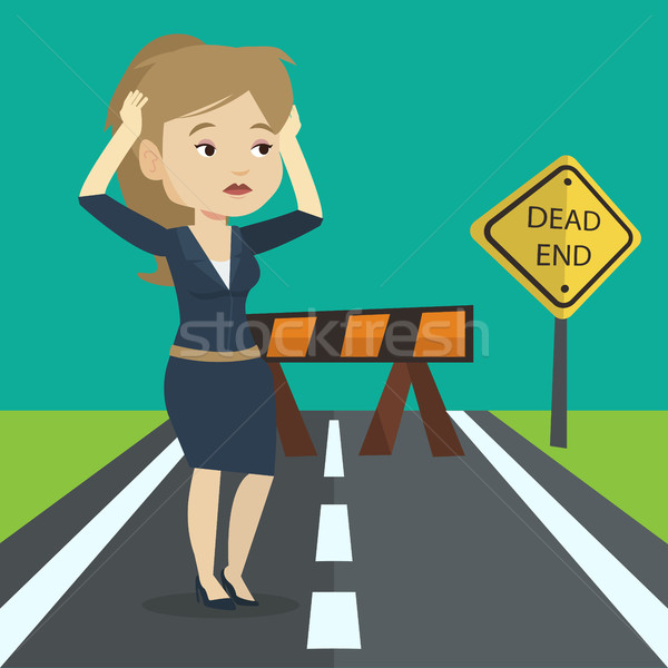 Businesswoman looking at road sign dead end. Stock photo © RAStudio