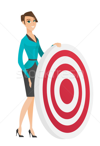 Young business woman and dart board. Stock photo © RAStudio