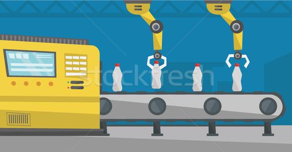 Robotic arm working on conveyor belt with bottles. Stock photo © RAStudio