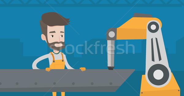 Homme travail industrielle soudage robotique bras Photo stock © RAStudio