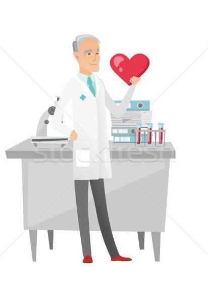 кавказский кардиолог большой красный сердце Сток-фото © RAStudio