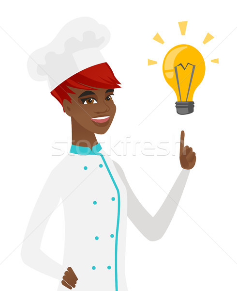 Young african-american chef pointing at lightbulb. Stock photo © RAStudio