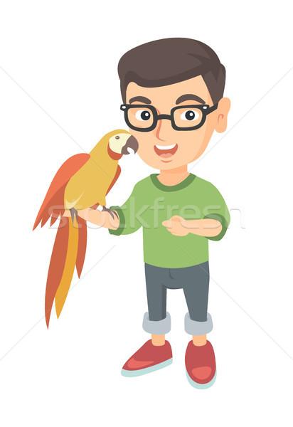 Kaukázusi kicsi fiú tart papagáj kéz Stock fotó © RAStudio