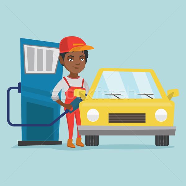 Afrikai munkás benzinkút megtankol autó fiatal Stock fotó © RAStudio