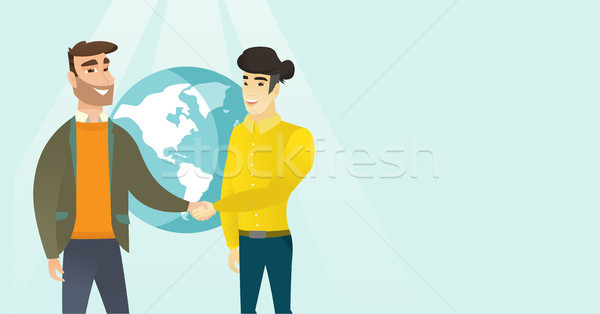 Young multiracial business partners shaking hands. Stock photo © RAStudio