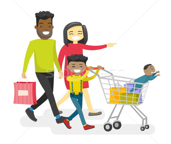 Happy multiracial family with biracial kids shopping. Stock photo © RAStudio