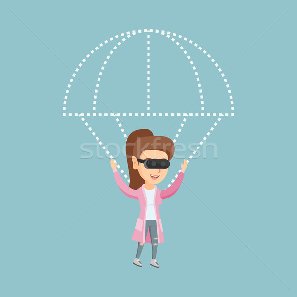 Young woman in vr headset flying with a parachute. Stock photo © RAStudio