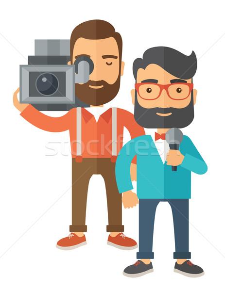 Новости репортер профессиональных кавказский журналист видеокамерой Сток-фото © RAStudio