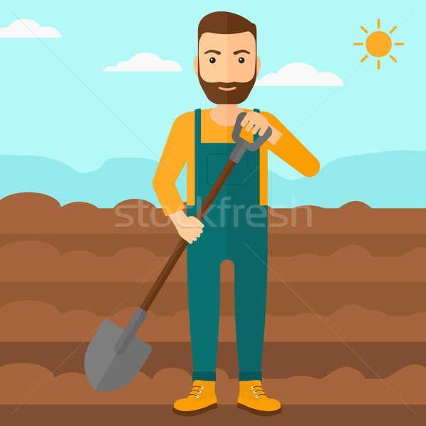 Farmer on the field with shovel. Stock photo © RAStudio