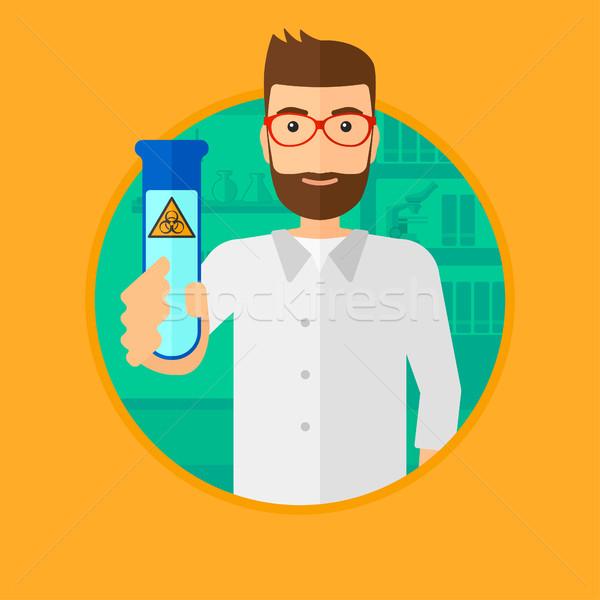 Scientist with test tube. Stock photo © RAStudio