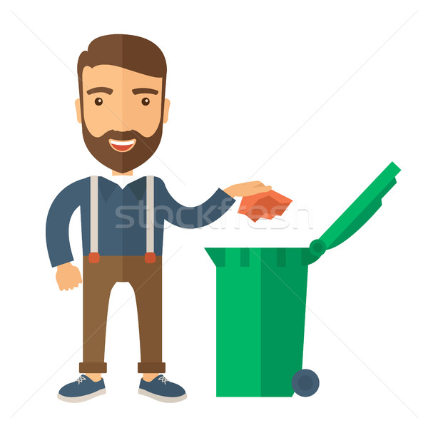 Stock photo: Man throwing paper in a garbage bin
