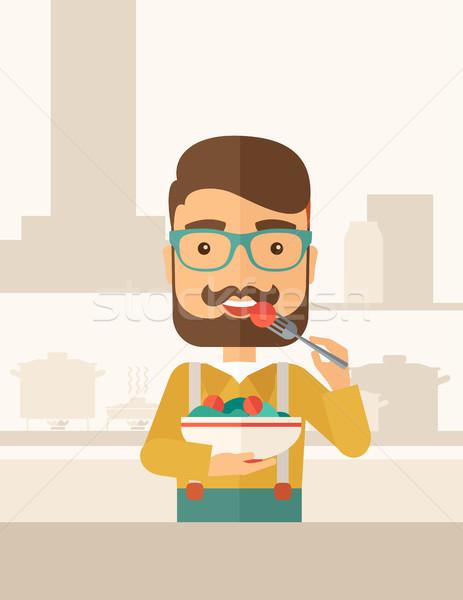 Aç adam yeme yemek çatal Stok fotoğraf © RAStudio