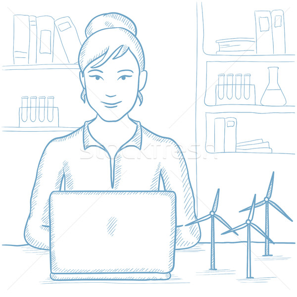 Woman working with model wind turbines on table. Stock photo © RAStudio