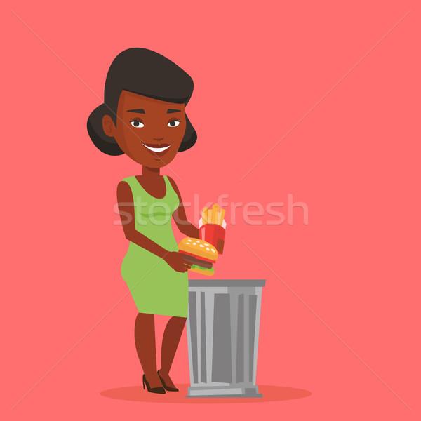 Woman throwing junk food vector illustration. Stock photo © RAStudio