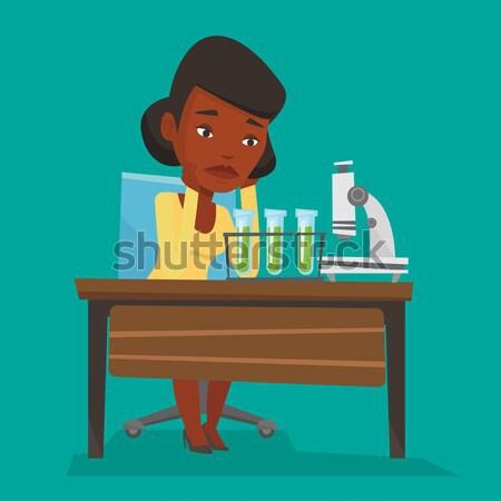 Estudante trabalhando laboratório classe africano cabeça Foto stock © RAStudio
