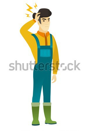Disappointed asian farmer with thumb down. Stock photo © RAStudio