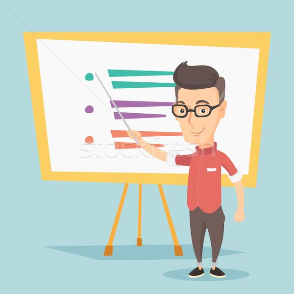 Teacher or student standing in front of board. Stock photo © RAStudio