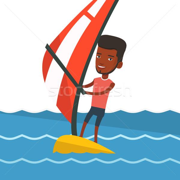 Fiatalember windszörf tenger férfi áll tábla Stock fotó © RAStudio