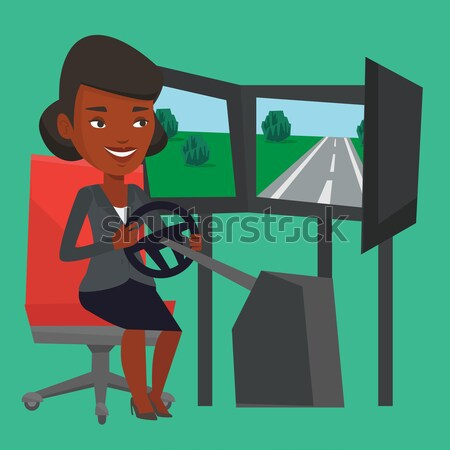 Woman playing video game with gaming wheel. Stock photo © RAStudio