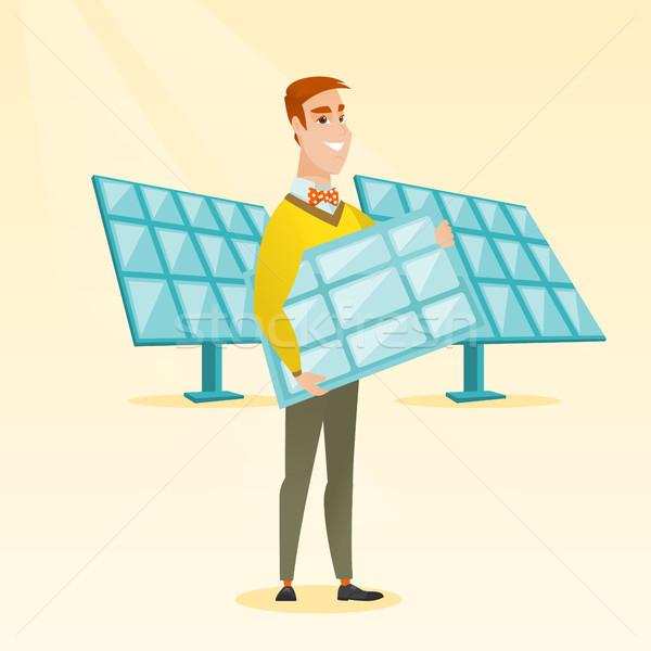Stock photo: Man holding solar panel vector illustration.