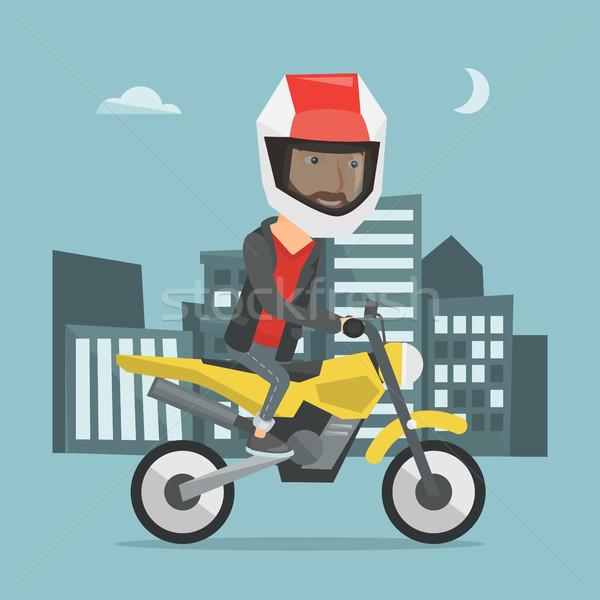человека верховая езда мотоцикл ночь молодым человеком шлема Сток-фото © RAStudio