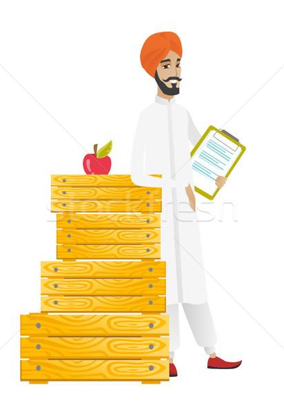 Farmer holding clipboard with documents. Stock photo © RAStudio
