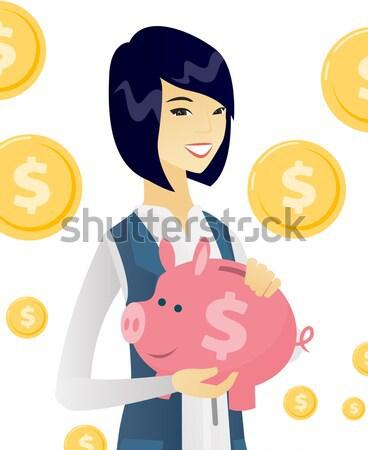 Hindu businessman holding a piggy bank. Stock photo © RAStudio