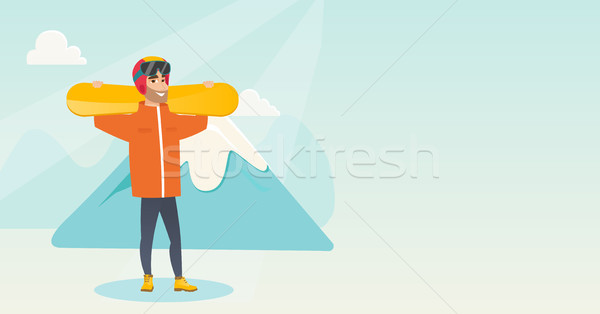 Young caucasian sportsman holding skis. Stock photo © RAStudio