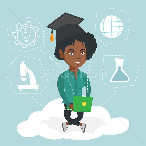 Сток-фото: молодые · африканских · выпускник · сидят · облаке · ноутбука
