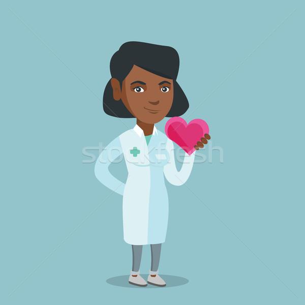 Młodych Afryki lekarza kardiolog serca Zdjęcia stock © RAStudio