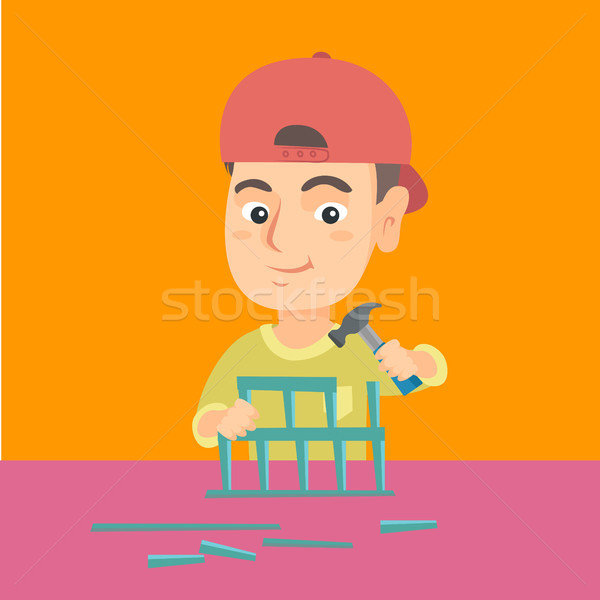Boy playing with toy constructor and hammer. Stock photo © RAStudio