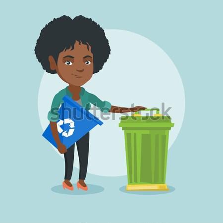 Little girl throwing banana peel in recycling bin. Stock photo © RAStudio