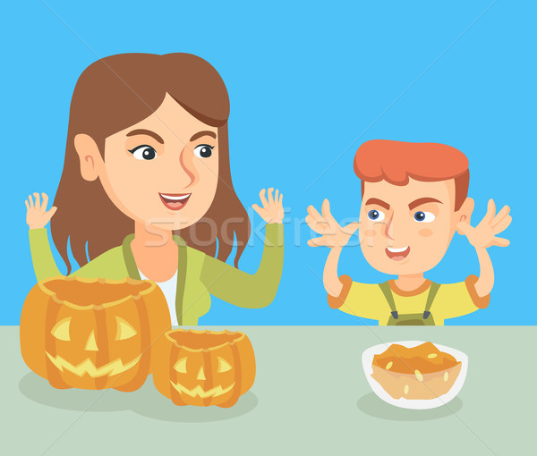 Mother and son carving pumpkins for Halloween. Stock photo © RAStudio
