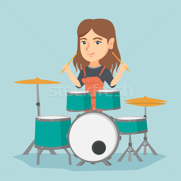 Young caucasian woman playing the drum. Stock photo © RAStudio