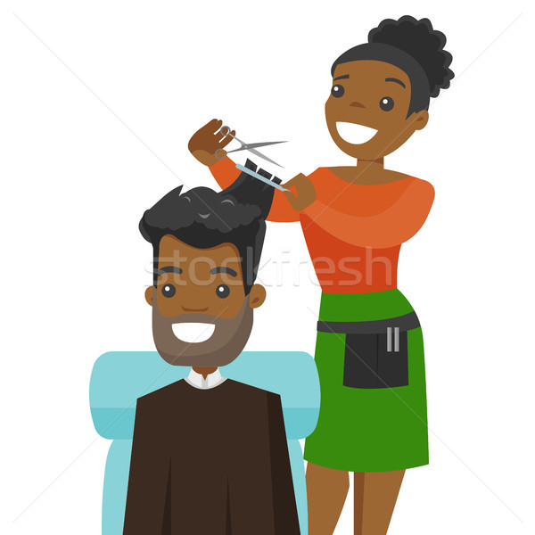 Hairdresser making a haircut to a young man. Stock photo © RAStudio