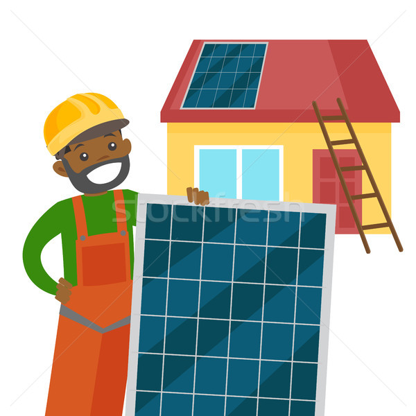 Young african constructor installing solar panel. Stock photo © RAStudio